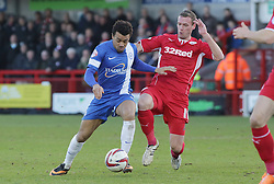 Peterborough United's Nicky Ajose in action with Crawley Town's Andy Drury - Photo mandatory by-line: Joe Dent/JMP - Tel: Mobile: 07966 386802 01/03/2014 - SPORT - FOOTBALL - Crawley - Broadfield Stadium - Crawley Town v Peterborough United - Sky Bet League One