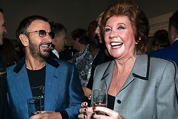 """**FILE PICTURE - Singer and presenter Cilla black has died at the age of 72** 19/05/2011. Beatle Ringo Starr and Cilla Black sharing a joke. Opening of the Tommy Nutter Exhibition """"Rebel on the Row"""" at the Fashion and Textile Museum, London. Photo credit should read BETTINA STRENSKE/LNP"""