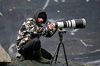 Photographer in the field (model release 03/08/HTNP), Hohe Tauern National Park, Carinthia, Austria