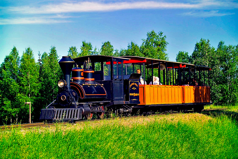 Alaska Fairbanks. Summer. El Dorado Goldmine tour offers visitors a chance to see a working goldmine, ride on a steam train and pan for gold.