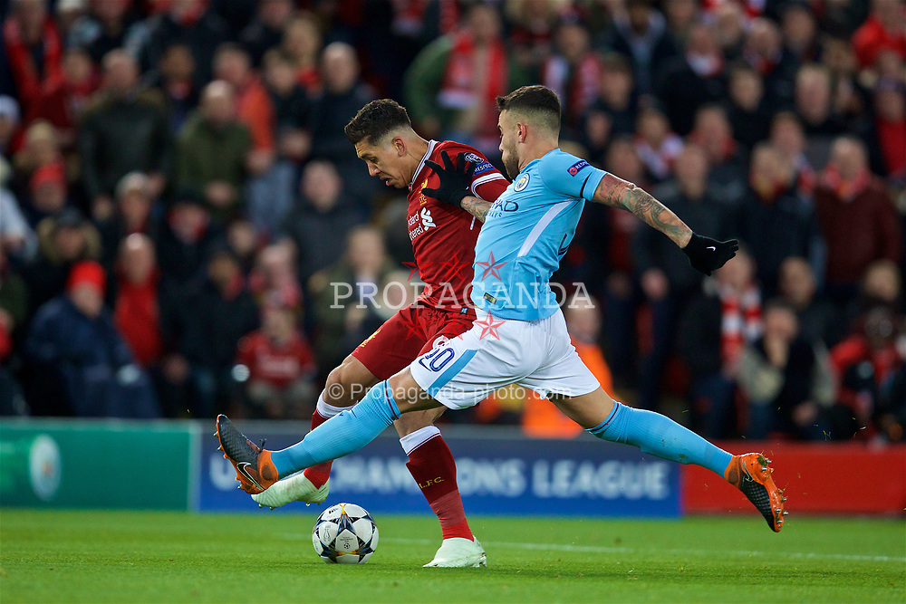 LIVERPOOL, ENGLAND - Wednesday, April 4, 2018: Liverpool's Roberto Firmino and Manchester City's Nicolas Otamendi during the UEFA Champions League Quarter-Final 1st Leg match between Liverpool FC and Manchester City FC at Anfield. (Pic by David Rawcliffe/Propaganda)