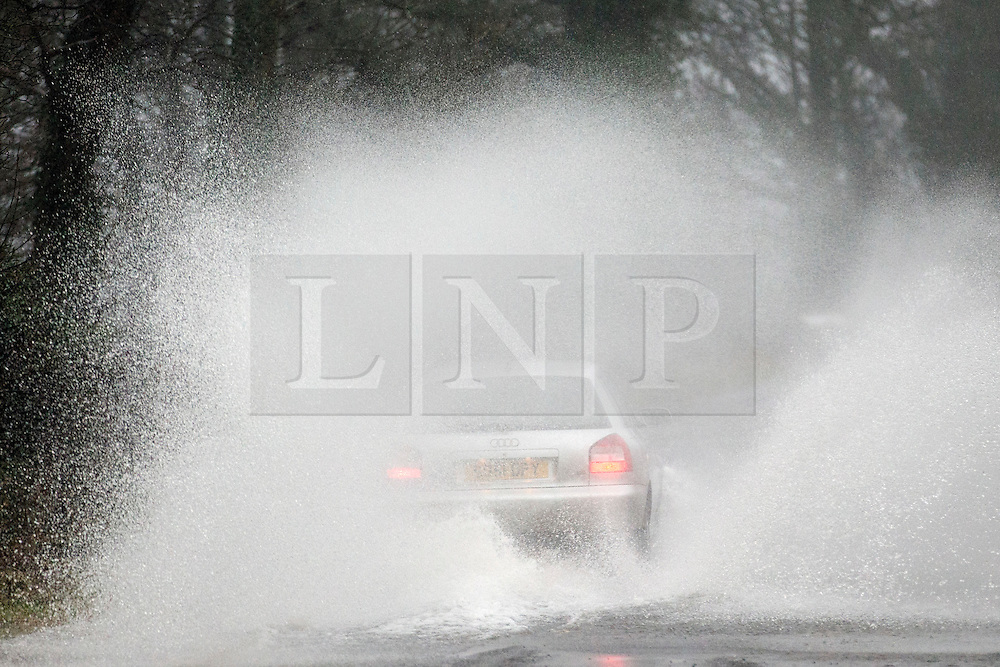 © Licensed to London News Pictures. 26/01/2016. Ullswater UK. Storm Jonas has arrived in Cumbria flooding roads around the lake of Ullswater this morning. Photo credit: Andrew McCaren/LNP