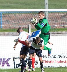 Falkirk's keeper Michael McGovern over Falkirk's Will Vaulks.<br /> Cowdenbeath 1 v 0 Falkirk, 14/9/2013.<br /> ©Michael Schofield.