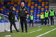 AFC Wimbledon manager Glyn Hodges making hand gesture on touchline during the EFL Sky Bet League 1 match between AFC Wimbledon and Bristol Rovers at Plough Lane, London, United Kingdom on 5 December 2020.