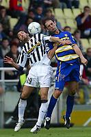Parma 18/4/2004 Campionato Italiano Serie A <br />30a Giornata - Matchday 30 <br />Parma Juventus 2-2 <br />Gianluca Zambrotta (Juventus) and Luciano Castellini (Parma)<br /> Foto Graffiti