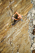 Pete Hurley climbing the loose and serious Hung like a Hamster, E5 6a, Craig Dorys, Lleyn, North Wales