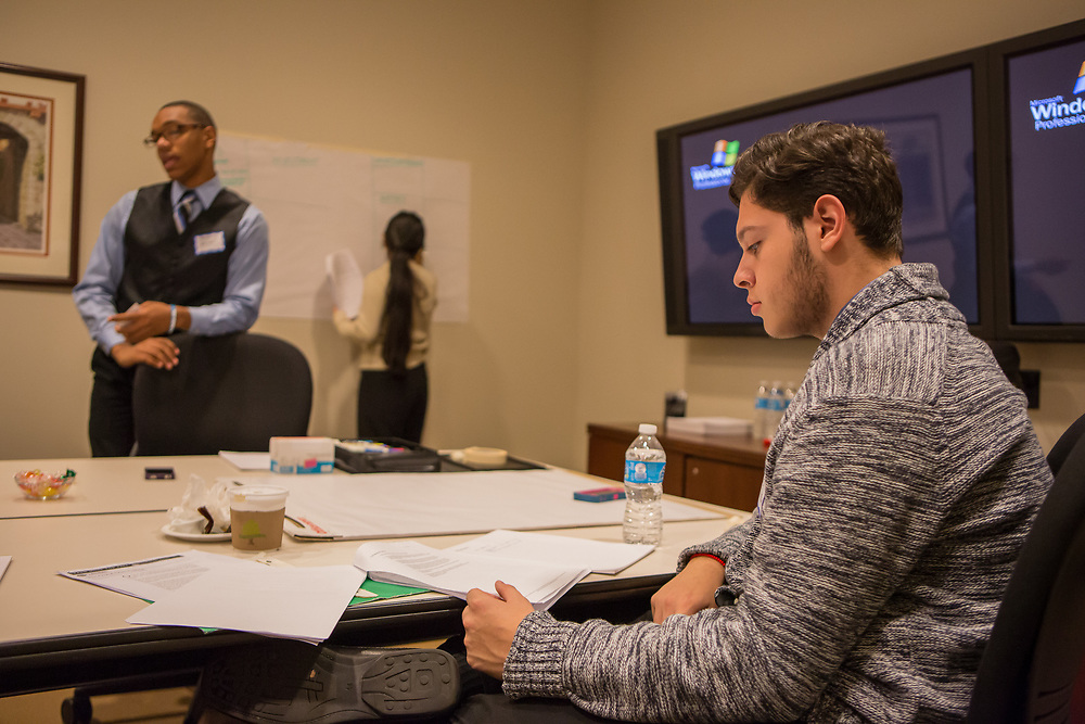Purchase, NY – 31 October 2014. ‐Peekskill High School student Ricardo Archila reviewing his case notes. The Business Skills Olympics was founded by the African American Men of Westchester, is sponsored and facilitated by Morgan Stanley, and is open to high school teams in Westchester County.