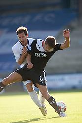 Raith Rovers Kevin Moon and Falkirk's Will Vaulks. <br /> Raith Rovers 1 v 1 Falkirk, Scottish Championship 28/9/2013.<br /> ©Michael Schofield.