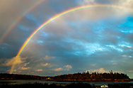 A double rainbow lights up the sky on Penobscot Bay, in S. Thomaston, Maine