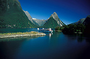 Milford Sound, New Zealand, showing boat and mountains