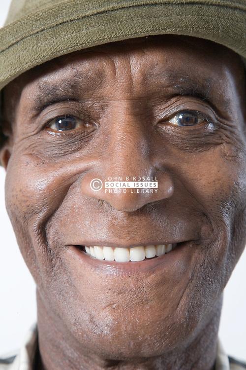 Portrait of an older man wearing a hat smiling,