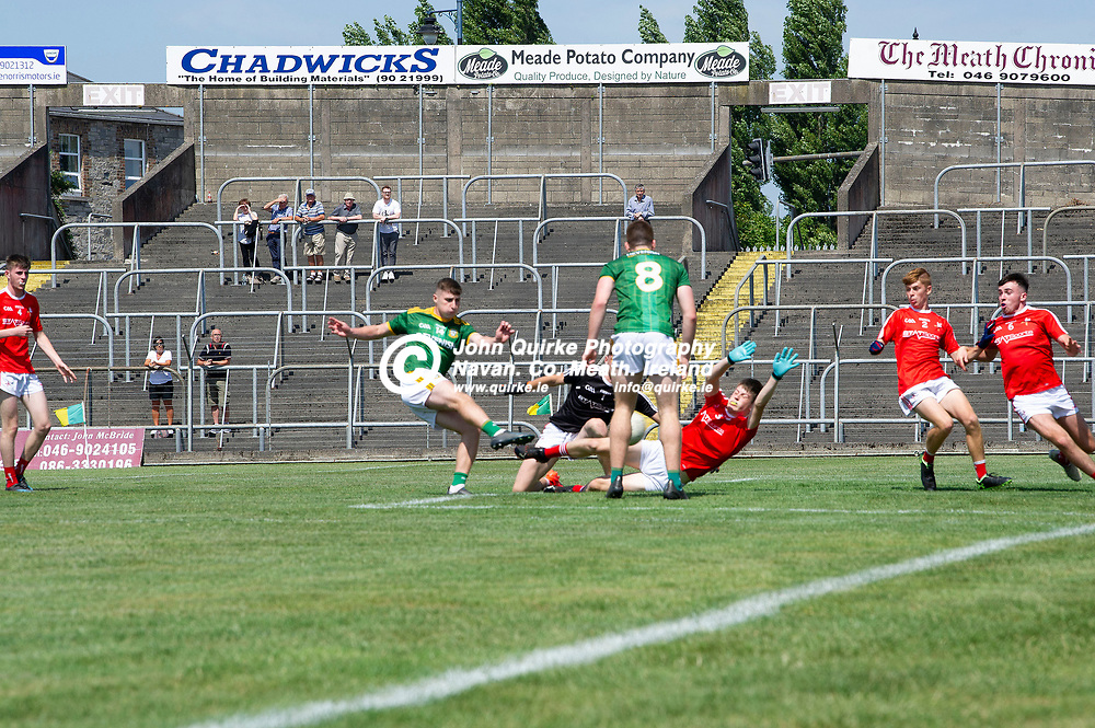 24-07-21. Meath v Louth - Leinster MFC Semi-Final at Pairc Tailteann, Navan.<br /> Oisin O'Murchu scoring a match winning goal for Meath.<br /> Photo: John Quirke / www.quirke.ie<br /> ©John Quirke Photography, 16 Proudstown Road, Navan. Co. Meath. (info@quirke.ie / 046-9028461 / 087-2579454).