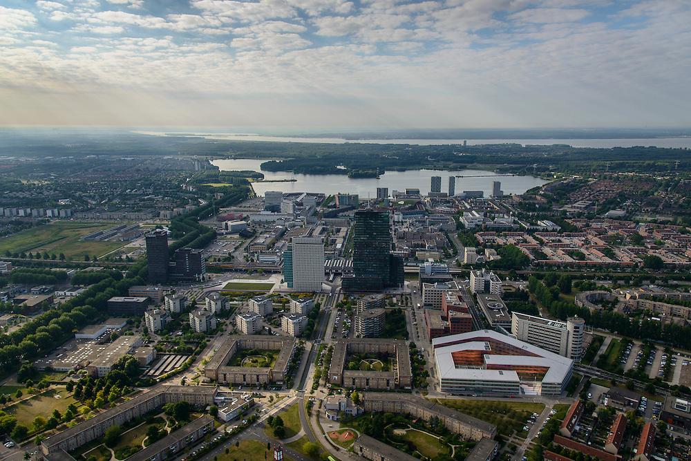 Nederland, Flevoland, Almere, 27-08-2013; Stadshart, met in het midden de RABObank en USG (li), Station NS en WTC, rechtsonder UWV (oranje binnengevel, La Defense van UNStudio architectenbureau Ben van Berkel en Caroline Bos) . Weerwater in de achtergrond. Aan de horizon het Gooimeer.<br /> Heart of the newly constructed city of Almere, in the middle of high-rise offices (Rabobank and WTC) and the railway station.  most remarkable building UWV building (orange inside, La Défense by UNStudio architect Ben van Berkel and Caroline Bos). On the horizon the Gooimeer.<br /> luchtfoto (toeslag op standaard tarieven);<br /> aerial photo (additional fee required);<br /> copyright foto/photo Siebe Swart.