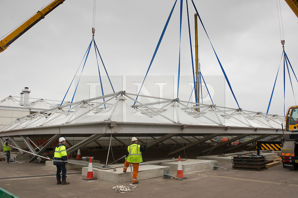 © Licensed to London News Pictures 14/02/2011 London, UK. .The last part of the roof structure of Heathrow's Olympic Games terminal is lifted into place. The new terminal  is for athletes departing Games and this along with baggage collection from the Athletes Village, will divert over 10,000 passengers and 37,000 bags from the main terminals..Photo credit : Simon Jacobs/LNP