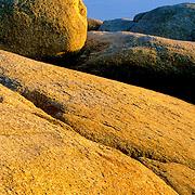 Rocky coast at sunset. Stonington, Maine