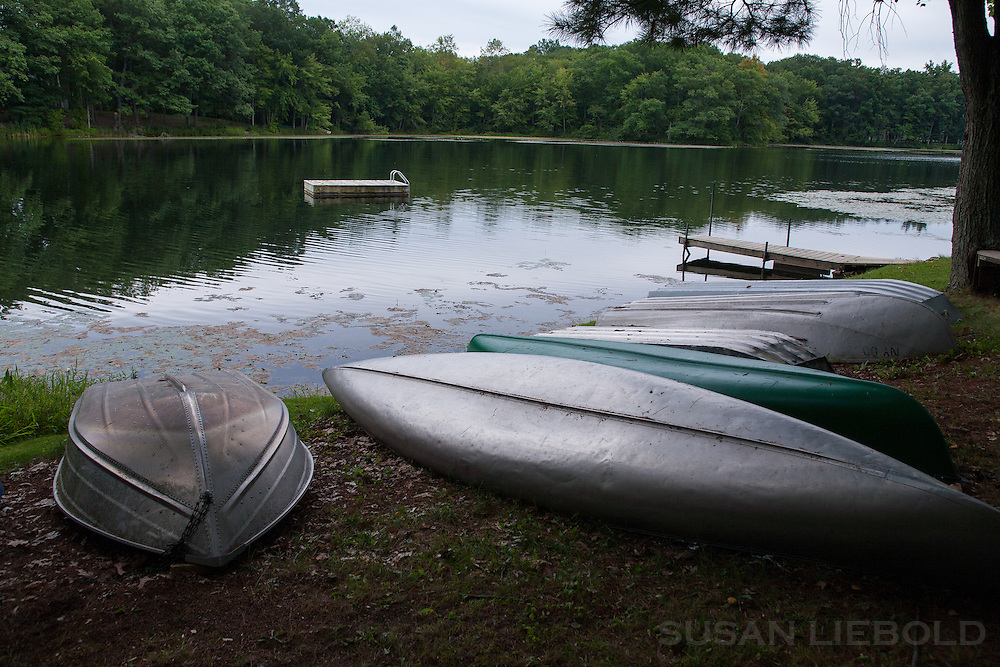 Boats on the grass at Copake Lake in New York.