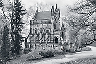 A gothic cathedral mausoleum in a beautiful arboretum / cemetery setting during autumn, Southwestern Ohio, USA