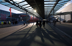 HANNOVER, GERMANY - MARCH-6-2008 - As the sun sets, visitors leave the CeBIT compound in Hannover, Germany. CeBIT is the world's largest computer fair, which attracts hundreds of thousands of visitors every year. (Photo © Jock Fistick)