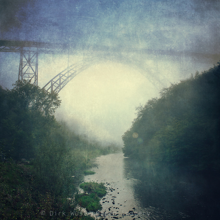 View over Müngstener Brücke, Germany and river Wupper on a misty morning. <br /> Prints & more: http://society6.com/DirkWuestenhagenImagery/Bridge-River-Fog_Print