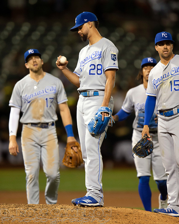 Sep 17, 2019; Oakland, CA, USA; Kansas City Royals starting pitcher Jorge Lopez (28) looks at the ball as he wait to be removed for a relief pitcher during the seventh inning of a baseball game against the Oakland Athletics at Oakland Coliseum. Mandatory Credit: D. Ross Cameron-USA TODAY Sports