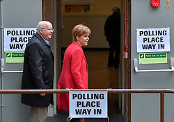 SNP leader Nicola Sturgeon and her husband Peter Murrell arrive at her local polling station in Glasgow to cast her vote in the European elections.<br /> <br /> © Dave Johnston / EEm