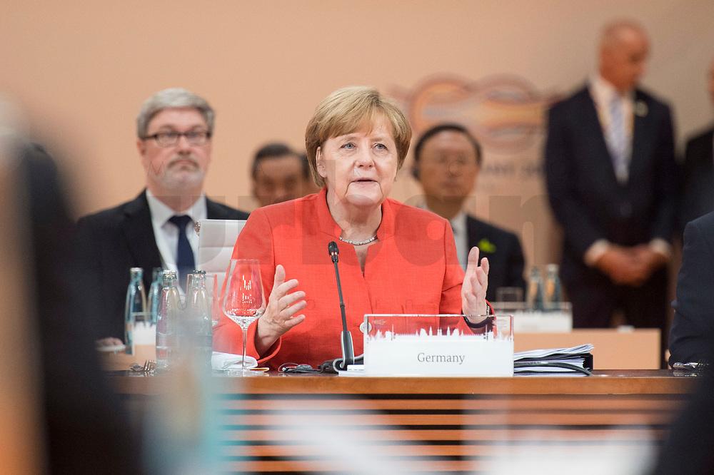 07 JUL 2017, HAMBURG/GERMANY:<br /> Angela Merkel, CDU, Bundeskanzlerin, helt die Eroeffnungsrede, 1. Arbeitssitzung, G20 Gipfel, Messe<br /> IMAGE: 20170707-01-014<br /> KEYWORDS: G20 Summit, Deutschland
