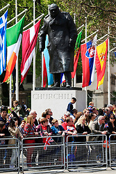 File photo dated 10/05/15 showing members of the public standing in front of the statue of Sir Winston Churchill, to watch the VE Day Parade to mark the 70th anniversary of VE Day, at Parliament Square in London, celebrating VE (Victory in Europe) Day in London, marking the end of the Second World War in Europe now 75 years ago.