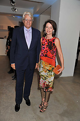 GERT-RUDOLPH & CORINNE FLICK at Arts for Human Rights gala dinner in aid of The Bianca Jagger Human Rights Foundation in association with Swarovski held at Phillips de Pury & Company, Howick Place, London on 13th October 2011.