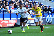 Bolton Wanderers' Neil Danns and Brentfords' Jake Bidwell chase the ball. Skybet football league championship match, Bolton Wanderers v Brentford at the Macron stadium in Bolton, Lancs on Saturday 25th October 2014.<br /> pic by Chris Stading, Andrew Orchard sports photography.