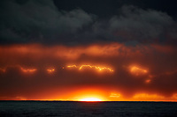 Angry electric clouds at sunrise over the Pacific Ocean from the deck of the MV World Odyssey. Traveling west from Hawaii to Japan. Semester at Sea, Spring 2016 voyage -- Day 11. Nikon 1 V3 camera and 70-300 mm lens (ISO 200, 224 mm, f/11, 1/60 sec).