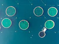 Aerial view of circular fish farm pools in the beautiful Mediterranean sea, Greece