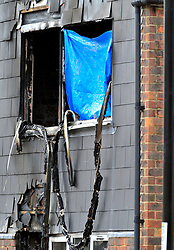 © Licensed to London News Pictures. 08/08/2018<br /> Deptford, UK. Fire damage to a window at a property where 7 year Joel Urhie was killed in a suspicious house fire at Adolphus Street, Deptford.  <br /> Photo credit: Grant Falvey/LNP