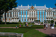 Pushkin, Russia -- July 22, 2019. Photo taken from the outside of Catherine Palace; tourists are admiring the lawn and gardens.