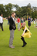 ELLIOT COWAN; HANNAH SHAW TREADING DIVOTS., 2008 Veuve Clicquot Gold Cup Polo final at Cowdray Park. Midhurst. 20 July 2008 *** Local Caption *** -DO NOT ARCHIVE-© Copyright Photograph by Dafydd Jones. 248 Clapham Rd. London SW9 0PZ. Tel 0207 820 0771. www.dafjones.com.
