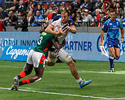 VANCOUVER, BC - MARCH 11: Ben Pinkelman (#2) of USA tackled by Oscar Ouma (#3) of Kenya during Game # 40- United States vs Kenya Cup SF 2 match at the Canada Sevens held March 10-11, 2018 in BC Place Stadium in Vancouver, BC. (Photo by Allan Hamilton/Icon Sportswire)