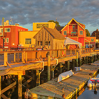 New England harbor scenery of Harriet Webster Pier at Maritime Gloucester in Gloucester on Cape Ann, Massachusetts.<br /> <br /> Beautiful Cape Ann sunrise photography pictures of Harriet Webster Pier at Gloucester Maritime are available as museum quality photography prints, canvas prints, acrylic prints, wood prints or metal prints. Fine art prints may be framed and matted to the individual liking and interior design decorating needs.<br /> <br /> Good light and happy photo making!<br /> <br /> My best,<br /> <br /> Juergen