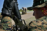 A recruit waits for his turn to fire his rifle at the range as another is offered instruction by one of the drill instructors.  Marine Corps Recruit Depot at Parris Island in South Carolina is where all male recruits living east of the Mississippi River and all female recruits from all over the US receive their arduous twelve week training in their quest to become marines. Even though there are two current active wars and a weak economy, recruitment has not been effected.  Actually, recruiting numbers have increased, with more young men and women looking toward the military for answers.