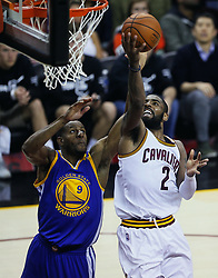 June 9, 2017 - Cleveland, OH, USA - The Cleveland Cavaliers' Kyrie Irving puts up a shot against the Golden State Warriors' Andre Iguodala in the fourth quarter during Game 4 of the NBA Finals at Quicken Loans Arena in Cleveland on Friday, June 9, 2017. The Cavs won, 137-116, trimming their series deficit to 3-1. (Credit Image: © Leah Klafczynski/TNS via ZUMA Wire)