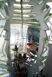 Fourth-order fresnel lens flashes white every 6 seconds at Pemaquid Point Lighthouse on the coast of Maine.