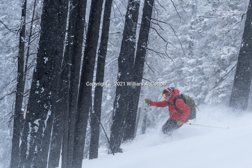 Colorado Sun reporter Jason Blevins skis through the Cameron Peaks Fire burn scar while accompanying Diamond Peaks Ski Patrol members on a duty day near Montgomery Pass, Feb. 6, 2021.