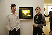 Justin Coombs and Memanie Craven, The Living Is Easy - private view . Flowers East, 82 Kingsland Road, London, E2, Mixed photography exhibition. 10 August 2006. ONE TIME USE ONLY - DO NOT ARCHIVE  © Copyright Photograph by Dafydd Jones 66 Stockwell Park Rd. London SW9 0DA Tel 020 7733 0108 www.dafjones.com