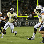 ORLANDO, FL - OCTOBER 09:  Quarterback Justin Holman #13 of the UCF Knights scrambles toward the end zone for a 5 yard touchdown at Bright House Networks Stadium on October 9, 2014 in Orlando, Florida. (Photo by Alex Menendez/Getty Images) *** Local Caption ***Justin Holman