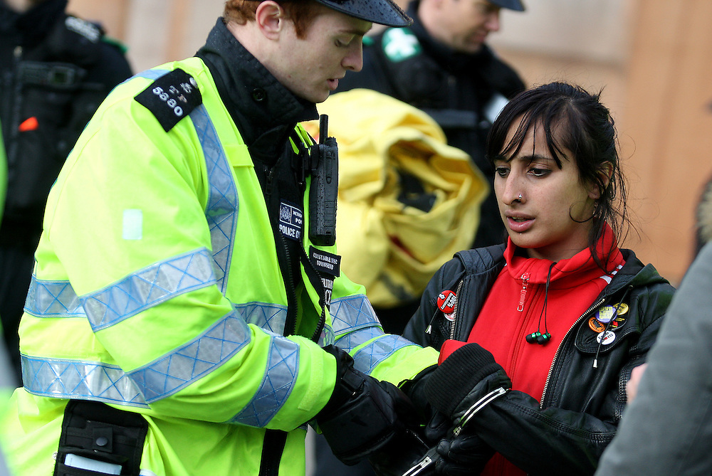 © UK News Pictures. 07/12/2011. Police making arrests at the demonstration against public sector cuts in central London