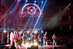Sir Tom Jones and Ladysmith Black Mambazo performing at the Royal Albert Hall in London during a star-studded concert to celebrate the Queen's 92nd birthday.