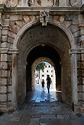 Tunnel through Revelin Tower and the land gate (Kopnena Vrata) entrance into the old town of Korcula. Korcula old town, island of Korcula, Croatia.