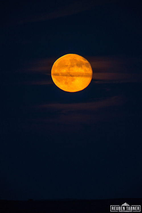 03.06.2015, Whitby, North Yorkshire. England. A Waning Gibbous moon (98.1%) rises above North Yorkshire glowing bright orange, almost as if it was on fire.