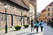 Young women visitors in Larochegatan by old town square in Malmo, Sweden