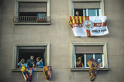 April 30, 2018 - Barcelona, Catalonia, Spain - FC Barcelona fans follow the club's open top bus victory parade after winning the LaLiga with their eighth double in the club history from their windows (Credit Image: © Matthias Oesterle via ZUMA Wire)