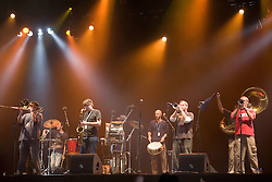 Members of Youngblood Brass Band playing instruments and drums on stage at the WOMAD (World of Music; Arts and Dance) Festival in reading; 2005,