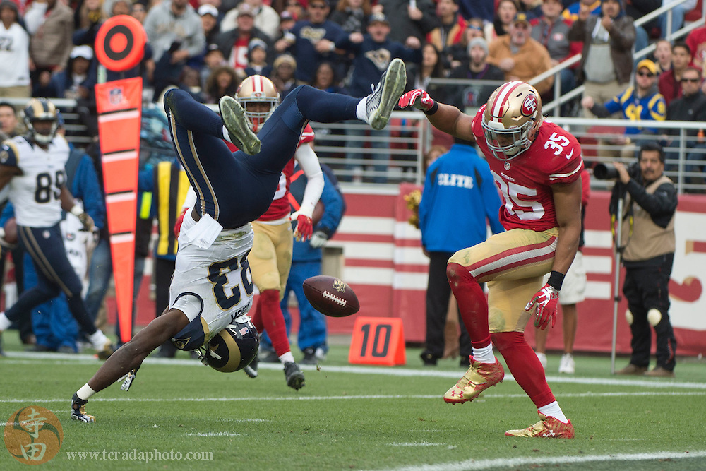 January 3, 2016; Santa Clara, CA, USA; St. Louis Rams wide receiver Brian Quick (83) is tackled by San Francisco 49ers free safety Eric Reid (35) for an incomplete pass during the second quarter at Levi's Stadium.